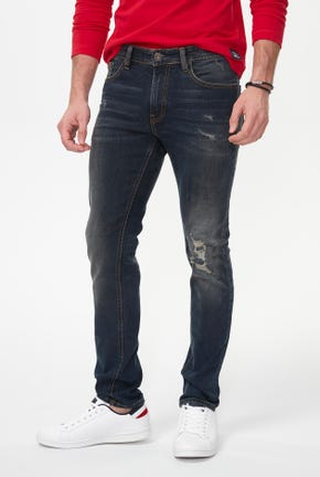 DESTROYED RUST SKINNY JEANS